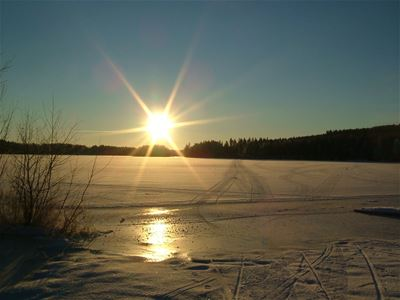 Sunset ower a lake, winter.