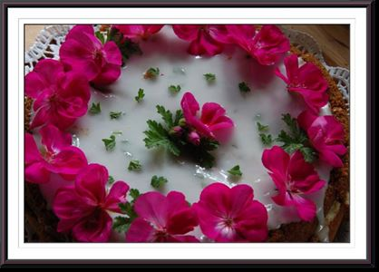 Cake with geranium flowers on.