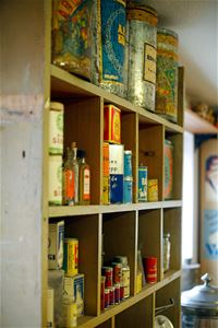 Shelves with different shapes on old tin cans.