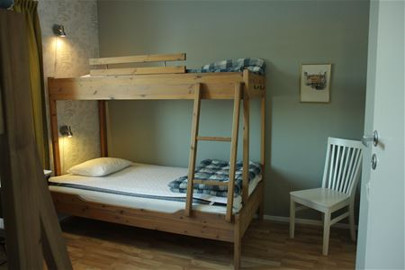 Guest room with one bunk bed.