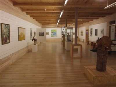 Exhibition hall with paintings on the walls.