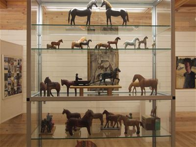 Glass stand with different horses.