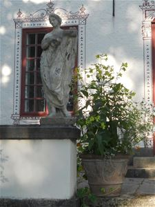 Statue outside the house.