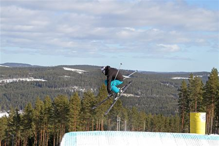 One person with skis jumping.