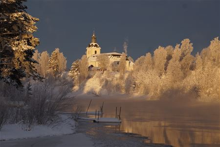 White church in a winter landscape.