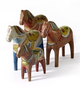 Four wooden dalahorses.