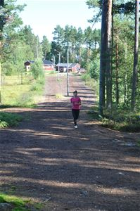 A runner on a gravel road.