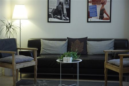 Welcoming common area with sofa and armchairs.