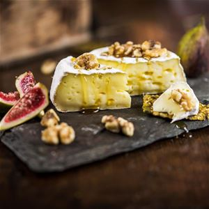 Brie cheese from the farm with honey and walnuts.