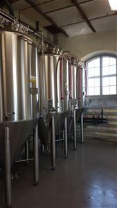 3 large tanks filled with organic beer.