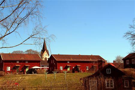View of red houses and a church.