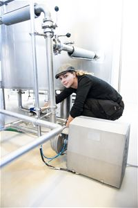 Woman working inside the brewery.