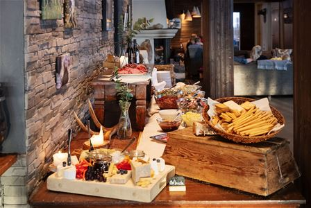 Part of the Buffet with cheese and bread on display.