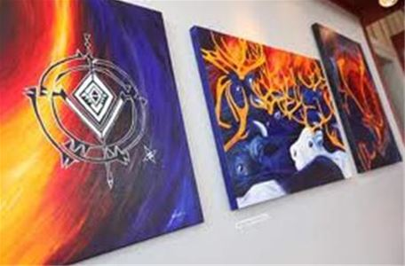 Sami art, paintings with Sami symbols and reindeer.
